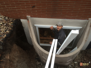 Egress window well installation contractor